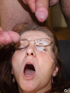 The nerdy mature in glasses and the suit is fucked at her work by eager guys