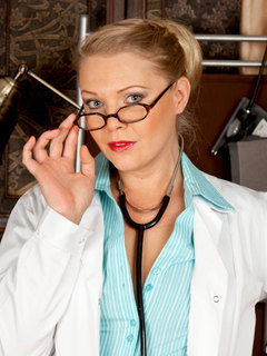Busty milf doctor unbuttons her uniform revealing her natural cleavage