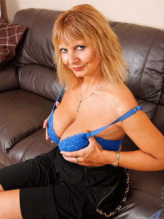 Busty Anilos Alex pinches her big boobs while wearing her bra on the couch