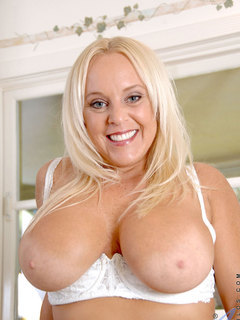 Horny mom with huge tits Alexis Golden washes dishes and stiffens your cock on top of the kitchen sink