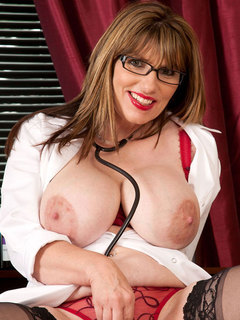 Horny Anilos pinches her big tits and stroking her pussy with a red toy on the couch