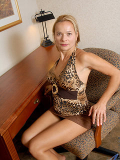 Sinful office assistant spreads her legs offering pleasing upskirt views