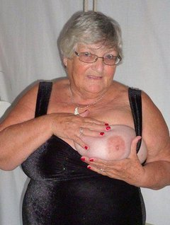 Just look at Granny all dressed up in this lovely evening dress which was made for me by one of my ardent fansyes a bi