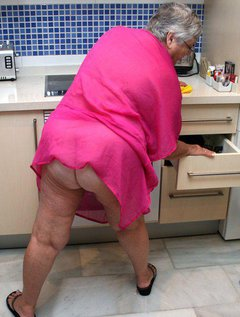 Even a sexy old granny like me has to do housework sometimes.Here you see me getting to grips with cleaning up the kit