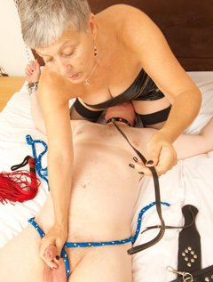 My Slave was chained to the Bed and I had tied his Cock and balls with Rope, I sat on his face while I tried to arouse h