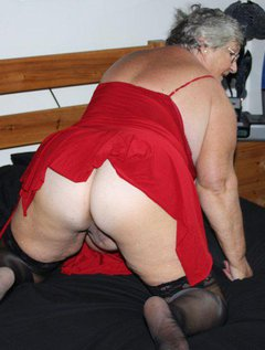 Grannys favourite red dress and black stockings.It looks good when I am fully dressedbut even better as I strip it o