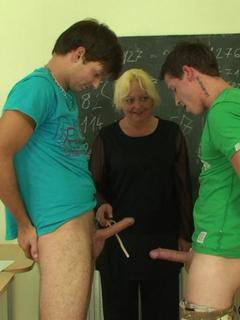 Aging teacher makes two of her students stay behind so they can nail her old pussy