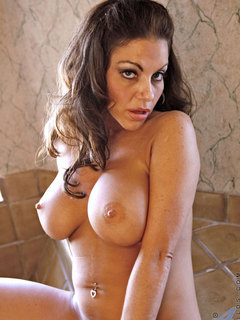 Glamorous brunette Anilos plays with her delicate pink milf pussy by the jacuzzi