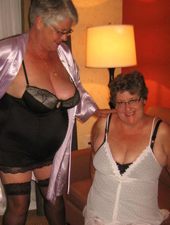 Sexy Girdlegoddess and Mistress Sue together in theirgirdles and lingerie,. They love to seduce you with there sexy se