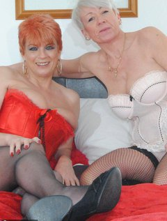 I hope you enjoy these photos of me and Dimonty in our basque's and topless.