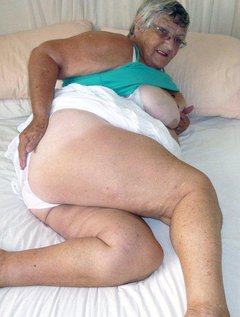 Grandma enjoys herself with a BIG BLACK dildo.This one just has top be my favourite toy.I soon strip naked on my bed
