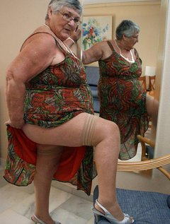 Grandma trying on a new dress. I have to look at it form all angles and make sure that, if needed, I can get it off easi