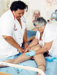 Nurses Libby and Gaby have a great time examining this patient.I am sure he was faking it because as soon as his favou