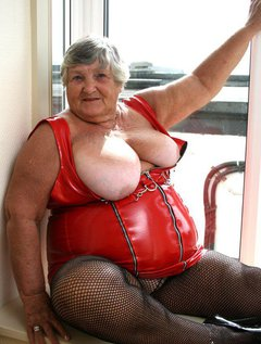 Tight red PVC clings provocatively to Grandma Libbys ample curvesI could only just squeeze into this dress so it was q