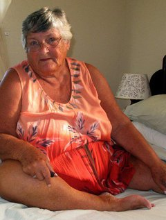 Showingoff those tan lines again This time Grandma relaxes on her bed letting you see her lovely tanned skin against h