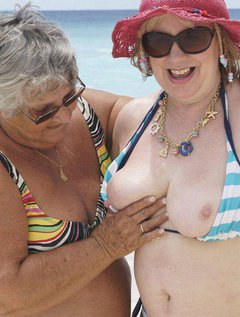 Grandma Libby on holiday with my best friend auntie trisha.As you can see we both love the beach and the water.We ha
