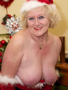 Hi Guys here I am as Mrs Santa stripping off and being Naughty in front of my Christmas tree, I have been a good girl th
