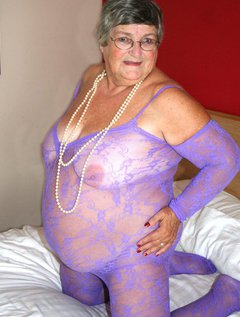 Grandma gets sexy on her bed showing off that gorgeous BBW body, big breasts and wet pussy.