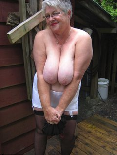 Girdlegoddess outside , always hot and horny. Day or nite...wearing my sexy girdle and stockings. Love to show you whats