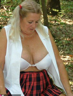 School girl in pigtails, plaid and lots of upskirt and boobs bursting from a tight blouse.